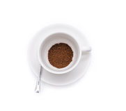 Ground coffee beans in white cup isolated Stock Photography