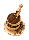 Ground coffee and beans in a wooden bowl Royalty Free Stock Photos