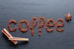 Ground coffee on a black ceramic table. Copy space, top view stock photo