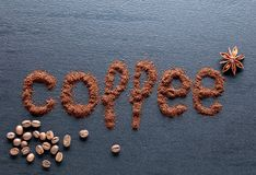 Ground coffee on a black ceramic table. Copy space, top view stock image