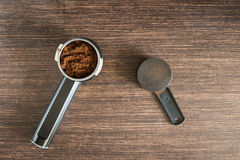 Ground coffee in brew unit on wooden counter Stock Photography