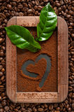 Ground coffee on the chalkboard with the background of coffee beans stock photos
