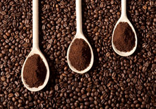 Ground coffee on coffee beans. Close up image Royalty Free Stock Photo