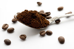 Ground coffee and coffee beans. White background Royalty Free Stock Photos