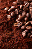 Ground coffee with coffee beans Royalty Free Stock Photo