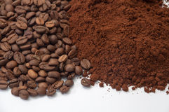 Ground coffee and coffee beans in the background Stock Photography