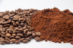 Ground coffee and coffee beans in the background Royalty Free Stock Photos