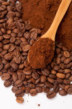 Ground coffee and coffee beans in the background and wooden spoo Stock Photography