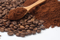 Ground coffee and coffee beans in the background and wooden spoo Stock Photo