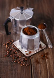 Ground coffee and coffee beans in a Moka Pot Stock Photography