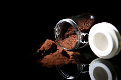 Ground coffee in a glass jar Royalty Free Stock Photography