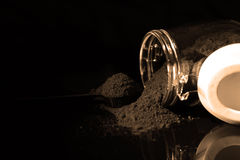 Ground coffee in a glass jar Stock Photography