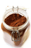 Ground coffee in a glass jar Royalty Free Stock Images