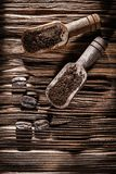 Ground coffee grains in scoop on vintage wooden board.  royalty free stock photography