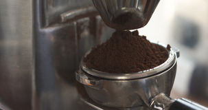 Ground coffee from grinder in portafilter for preparing espresso Royalty Free Stock Photo
