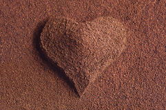 Ground coffee with a heart Stock Image