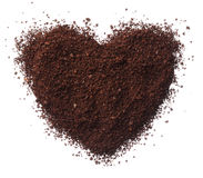 Ground coffee heart isolated on white background close up Royalty Free Stock Images