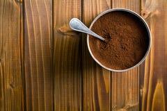 Ground coffee in metal jar Royalty Free Stock Images