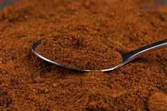 ground coffee and a metal spoon Royalty Free Stock Image