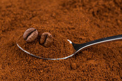 ground coffee and a metal spoon Royalty Free Stock Photography
