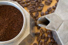 Ground coffee in moka pot. Stock Photos