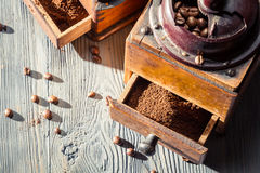 Ground coffee in the old-fashioned grinders Royalty Free Stock Images