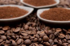 Ground Coffee On Coffe Beans Royalty Free Stock Photography