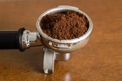 Ground coffee in a portafilter. Prepare to make espresso coffee royalty free stock photography