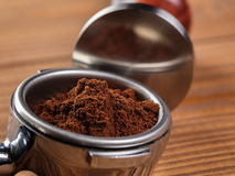 Ground coffee in portafilter ready for tamping Royalty Free Stock Images