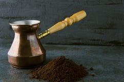 Ground coffee,pot - preparing morning coffee in the dark kitchen stock image
