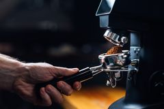 Free Ground Coffee Pouring Into A Portafilter With A Grinder Royalty Free Stock Photography - 166226267