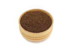 Ground coffee powder in a wooden bowl. On a white background royalty free stock photography
