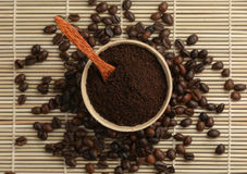 Ground coffee with a spoon. Cup filled with ground coffee on a background coffee straw stock images