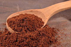 Ground coffee in a spoon Royalty Free Stock Photography