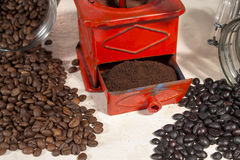 Ground coffee into a traditional manual coffee grinder Stock Photo