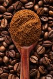 Ground coffee in a vintage spoon on coffee beans Stock Photos