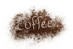 Ground coffee white background. The word coffee written against scattered natural coffee isolated on a white background Royalty Free Stock Images