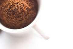 Ground coffee in white cup. Ground coffee powder in white cup Stock Image