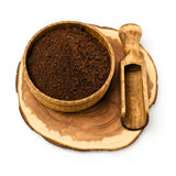 Ground coffee in a wooden bowl Royalty Free Stock Photography