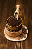 Ground coffee in a wooden bowl Royalty Free Stock Photo