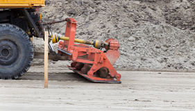 Ground compaction device. Detail of constructional device attached to truck for ground leveling and compacting for road construction Royalty Free Stock Image