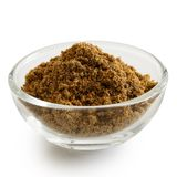 Ground cumin in glass bowl. Ground cumin in glass bowl isolated on white Royalty Free Stock Images
