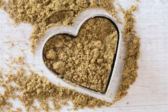 Ground cumin. In heart shape Royalty Free Stock Photography