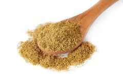 Ground cumin powder. In wooden spoon isolated on white background royalty free stock photo