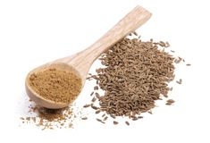 Ground cumin in a wooden spoon Stock Images