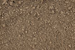 Ground detailed texture, brown background. Arable land. Brown background, arable land. Dark fon. The soil. Ground detailed texture. High resolution Stock Photos