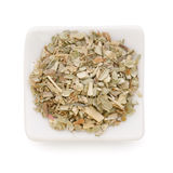 Ground dried basil (sweet basil) in a white bowl stock image