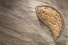 Ground flax seeds in the bowl - Linum usitatissimum stock photos