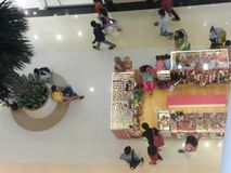 Ground flor Mall view from top floor. People are walking and shopping in a mall Royalty Free Stock Photo