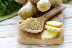Ground ginger in a wooden spoon Royalty Free Stock Photos
